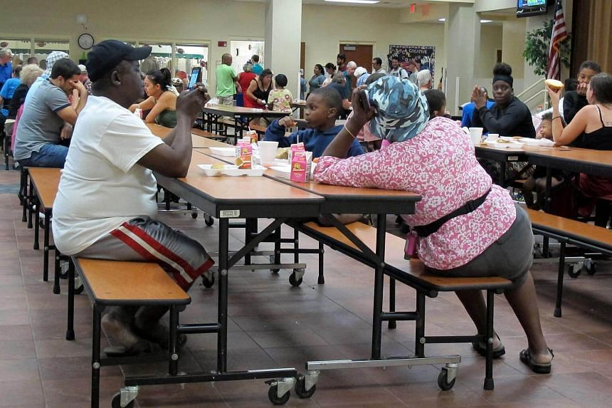 Residents eating at a school being used as a shelter while Hurricane Matthew approaches in Melbourne, Florida, US on Oct 6.