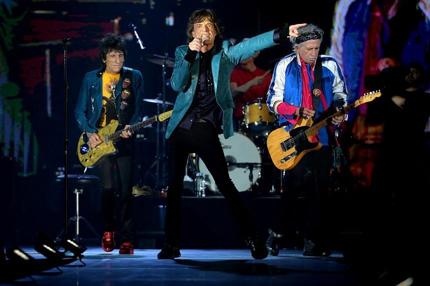 Legendary British rock band Rolling Stones, led by frontman Mick Jagger (centre), performing at a concert held at the Grand Ballroom of Marina Bay Sands on March 15, 2014.