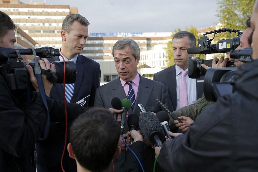 Nigel Farage (center), United Kingdom Independence Party member and Member of the European Parliament, talks to journalists as he leaves the Hautepierre Hospital in Strasbourg, France on Oct 6, 2016.