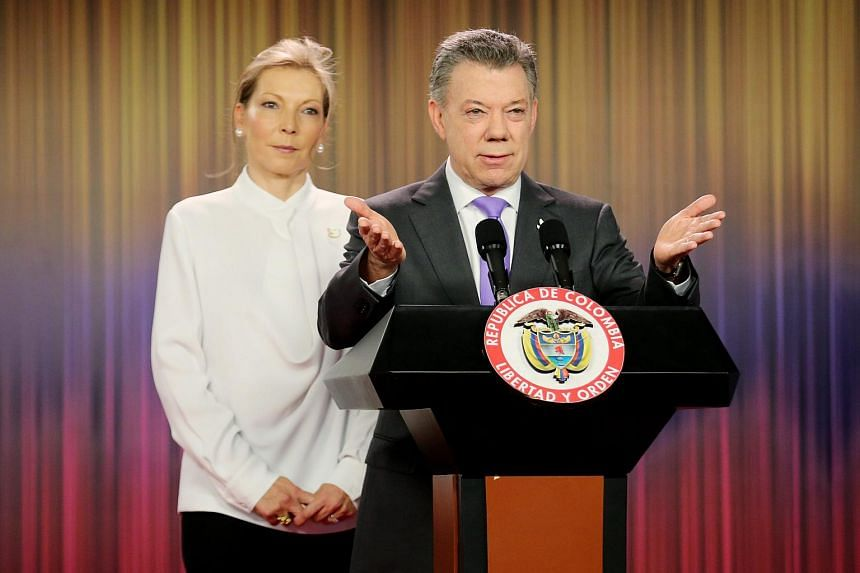 Colombian President Juan Manuel Santos and his wife Maria Clemencia Rodriguez attend a press conference in Bogota, Colombia after his Nobel Peace Prize win on Oct 7, 2016.
