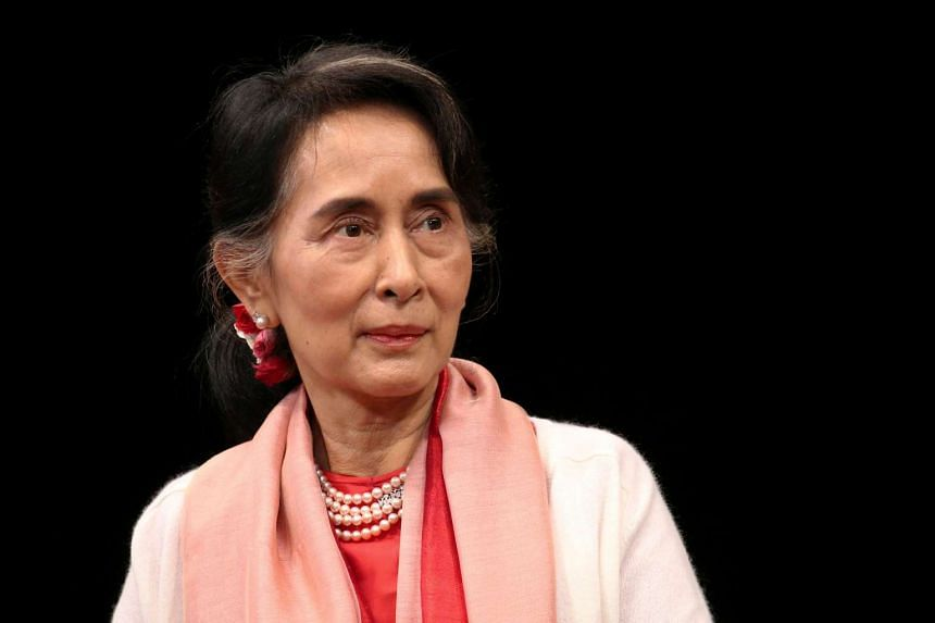 Two villagers have been charged for allegedly going on an obscenity-laced rant against Myanmar leader Aung San Suu Kyi (above).