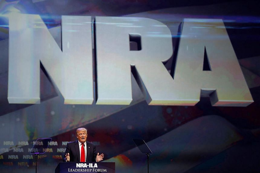 Donald Trump attends the National Rifle Association's NRA-ILA Leadership Forum during their annual meeting in Louisville, Kentucky on May 20, 2016.