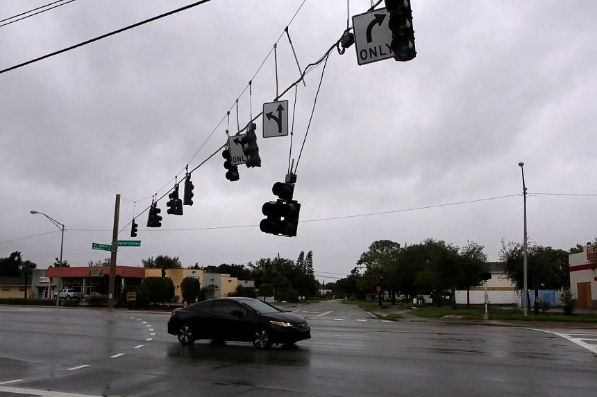 A traffic lamp damaged by wind is seen after Hurricane Matthew hits in Melbourne, Florida on Oct 7, 2016.
