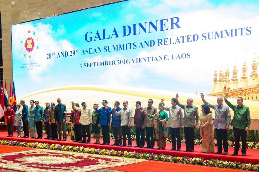 World leaders pose for a photo line-up during the gala dinner on the second day of the Association of Southeast Asian Nations Summit in Vientiane on Sept 7, 2016.
