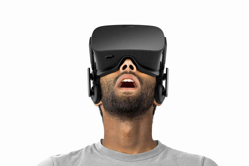 The Oculus Rift virtual reality head-mounted display headset allows users to experience an immersive virtual world in which they can move, interact with objects, and shoot weapons.