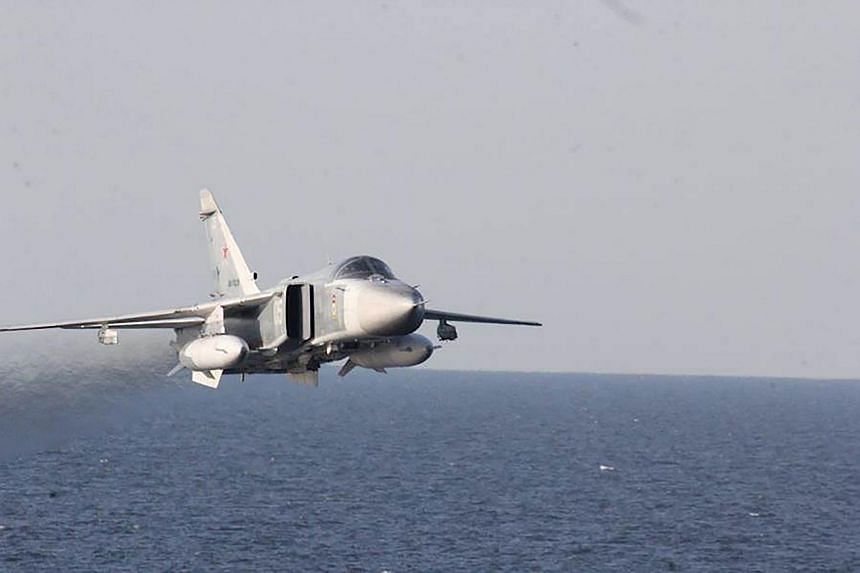A Russian Sukhoi Su-24 attack aircraft flying over the Baltic Sea.