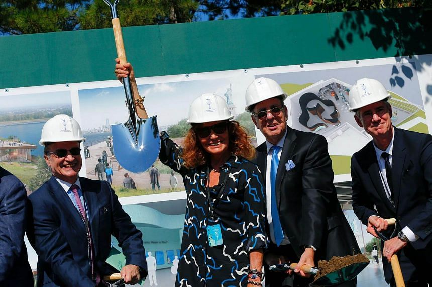 Fashion designer Diane von Furstenberg (centre-left) and Stephen Briganti (centre-right), Statue of Liberty-Ellis Island Foundation President and CEO, attend a ceremony to unveil plans and break ground for a new Statue of Liberty Museum on Liberty Is