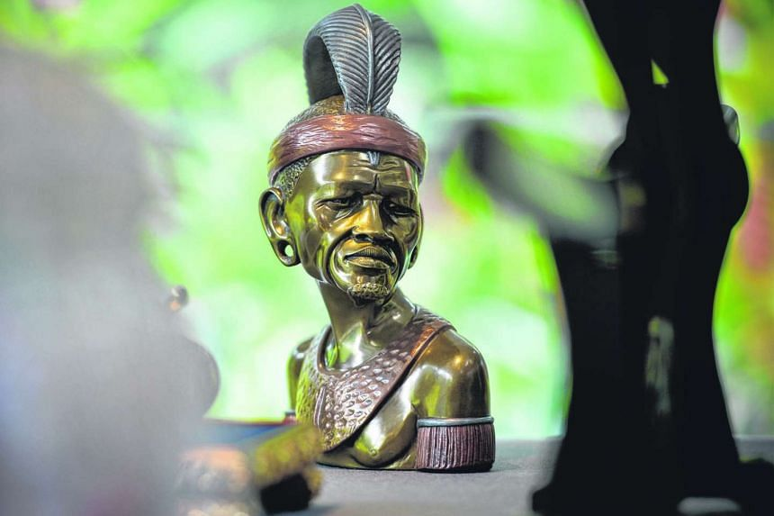 A tribal head from former South African President Nelson Mandela that was a gift to the late President Ong Teng Cheong.
