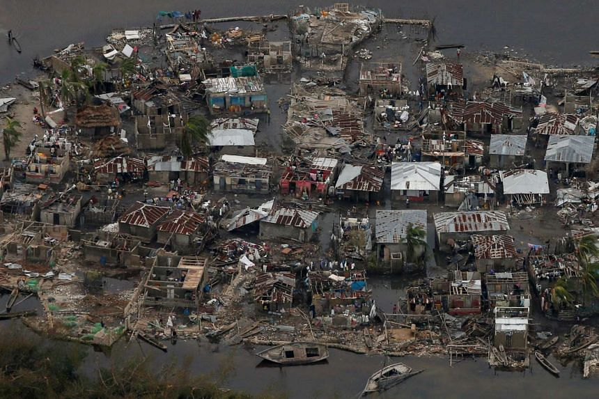 Destroyed houses are seen in a village after Hurricane Matthew passes Corail, Haiti, on October 6, 2016.