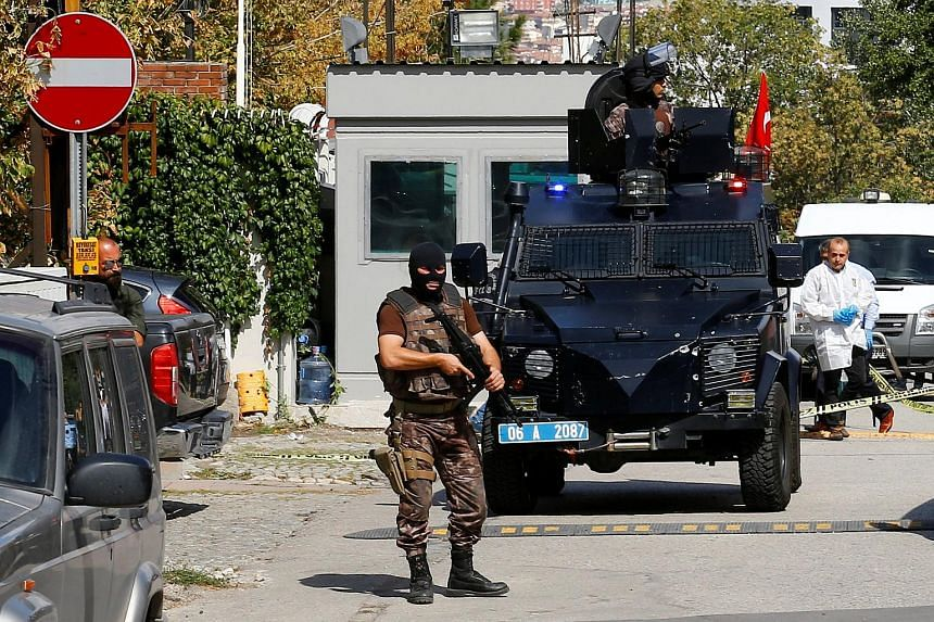 A member of the police special forces stands guard in front of the Israeli Embassy in Ankara, Turkey on Sept 21, 2016.