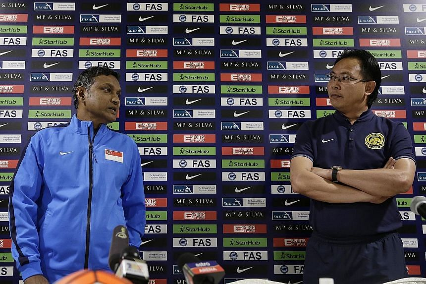 Lions caretaker coach V. Sundramoorthy and Malaysia boss Ong Kim Swee at yesterday's press conference at Amara Hotel. The duo are preparing for their second touchline battle, with Ong prevailing in the first.