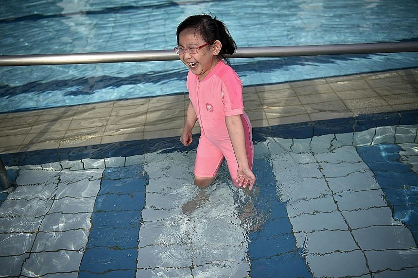 Lim En Xuan enjoying herself at a swimming complex on Monday. She could not go near a pool in the past because of fears of infection, but now that she has a new kidney, learning to swim is at the top of her to-do list.