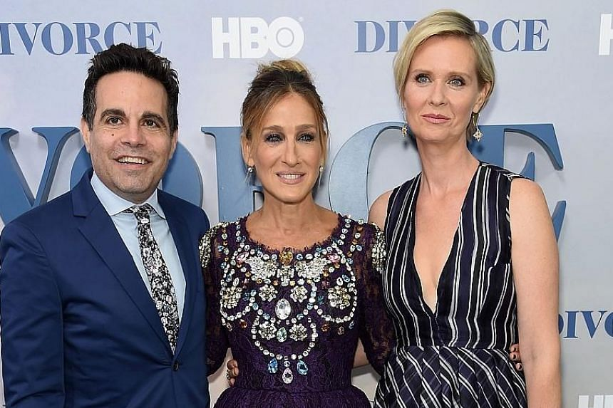 "Actress Sarah Jessica Parker (centre) hinted that talks were under way for a third Sex And The City movie while at the premiere of her television series Divorce on Tuesday. ""I described it as being not on the table, but in the warming drawer,"" she sa"