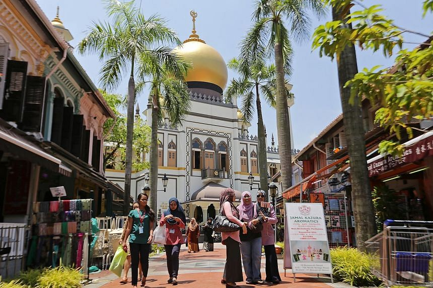 Above: The Sultan Mosque had a $4.6 million makeover. The Muscat Street mosque was one of four winners of the URA's Architectural Heritage Awards yesterday - it won in the restoration category. Below: The Goh Loo Club in Club Street, a gathering spot