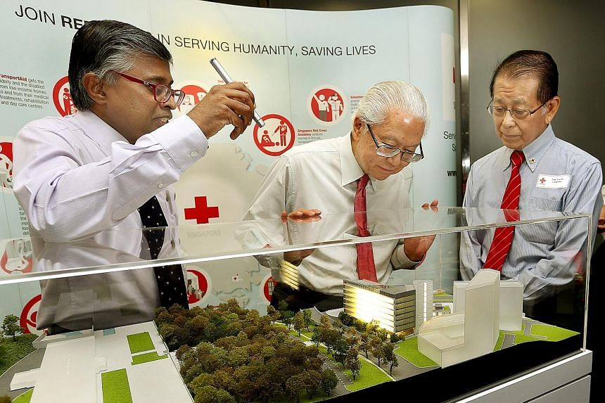 From far left: SRC secretary- general Benjamin William; SRC's patron, President Tony Tan Keng Yam; and SRC chairman Tee Tua Ba with a model of the SRC's new building, which will be located beside its current building.