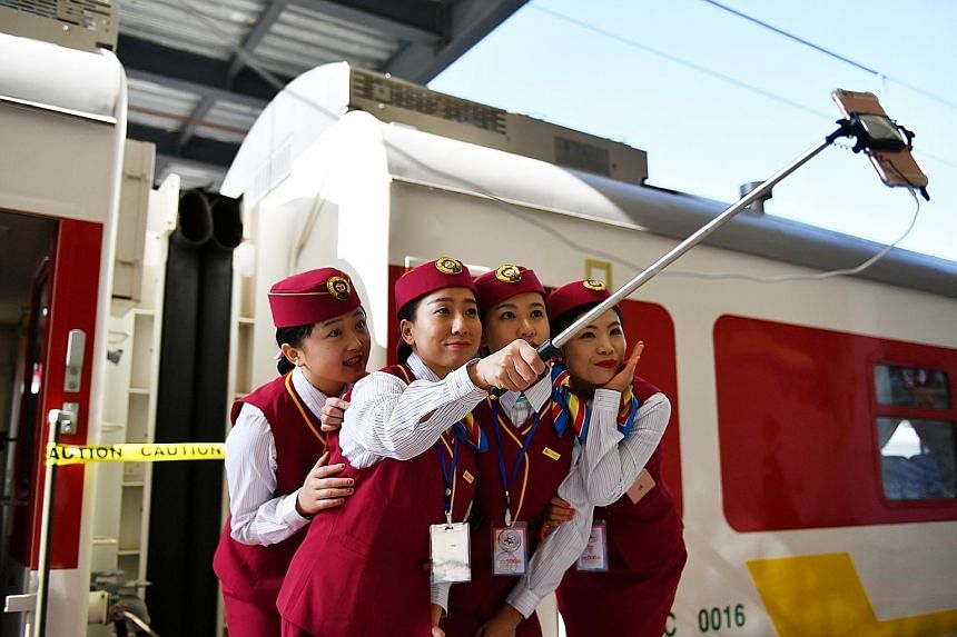 Chinese train attendants taking a wefie before the start of the Addis Ababa-Djibouti passenger rail service on Wednesday.