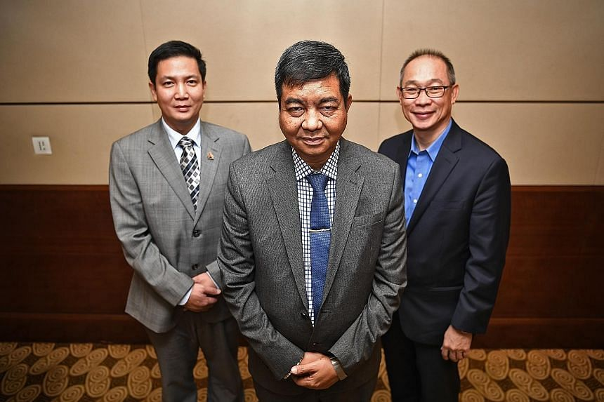 At a media event yesterday to launch its representative office in Singapore were (from left) KBZ Bank deputy managing director U Zaw Lin Aung, who is based in Singapore; senior managing director U Nyo Myint; and executive consultant Dexter Tan. The b
