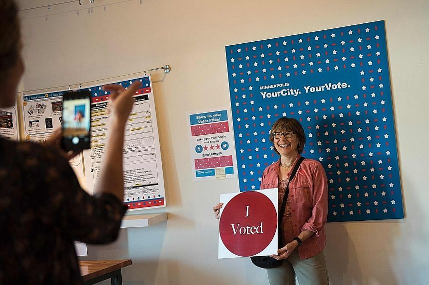 An early voter recording the event in Minneapolis, Minnesota, on Wednesday. For the first time, the Organisation of American States will send 30 to 40 observers to monitor the ballot on Nov 8, and the Organisation for Security and Cooperation in Euro