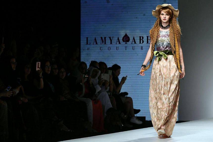 A model presents a creation by Emirati fashion designer Lamya Abedin at the Arab Fashion Week in Dubai on Oct 6, 2016.
