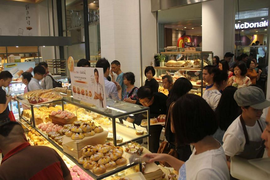 Shoppers gathered at the Tiong Bahru outlet to purchase the new collection.