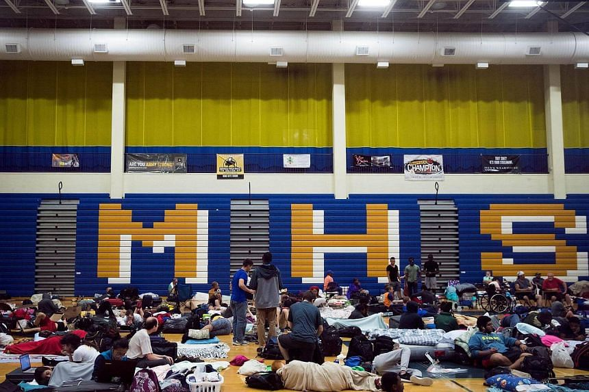 People take shelter from Hurricane Matthew at Mainland High School on Oct 6, 2016, in Jacksonville, Florida.