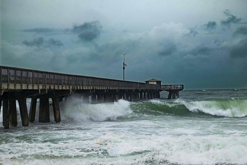 Waves pounding the Pompano Beach Fishing Pier due to the inclement weather caused by Hurricane Matthew on Oct 6, 2016, in Pompano beach, Florida.