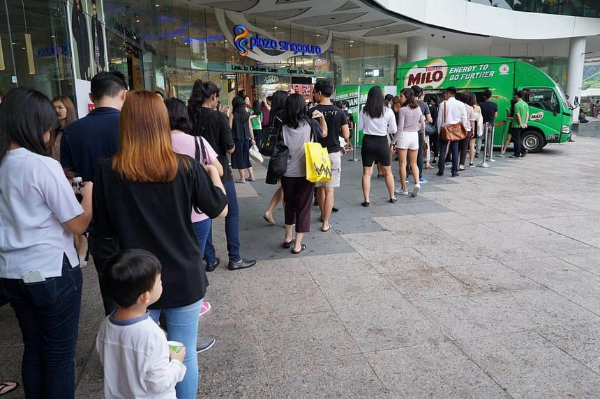 The lunchtime crowd waiting in the queue for free cups of Milo.