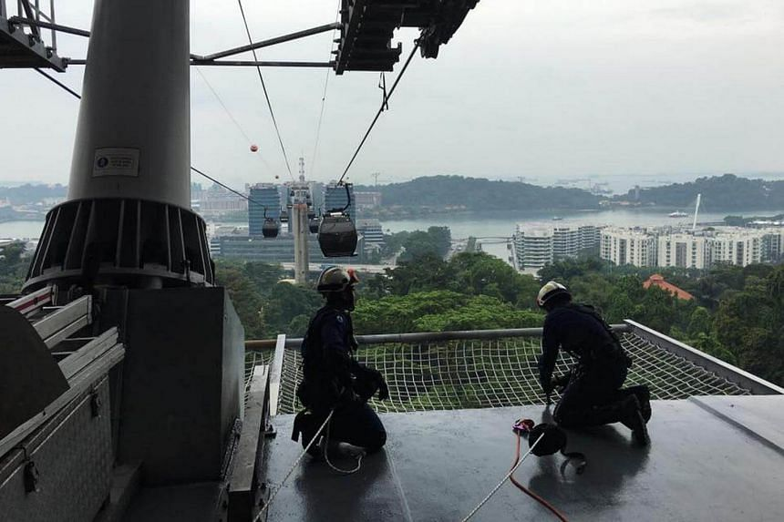 SCDF officers from the elite Disaster Assistance and Rescue Team (Dart) conducted a half-day height rescue exercise on Oct 6 which simulated the urgent retrieval of passengers from a stranded cable car.