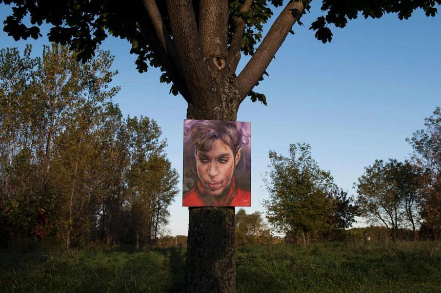 A portrait of Prince by artist Daniel Lacey hangs outside Paisley Park in Chanhassen, Minnesota on Oct 6, 2016.