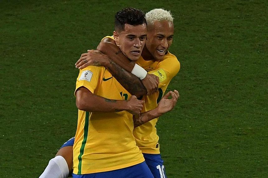 Brazil's Philippe Coutinho (left) celebrating his goal against Bolivia with teammate Neymar during their Russia 2018 World Cup qualifier football match in Natal, Brazil, on Oct 6, 2016.
