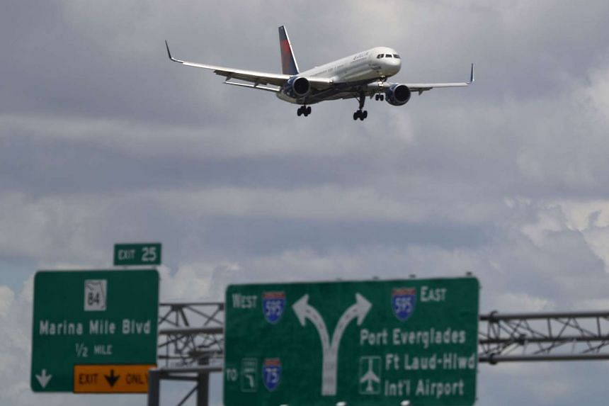 A plane comes in for landing at Fort Lauderdale, in Florida.