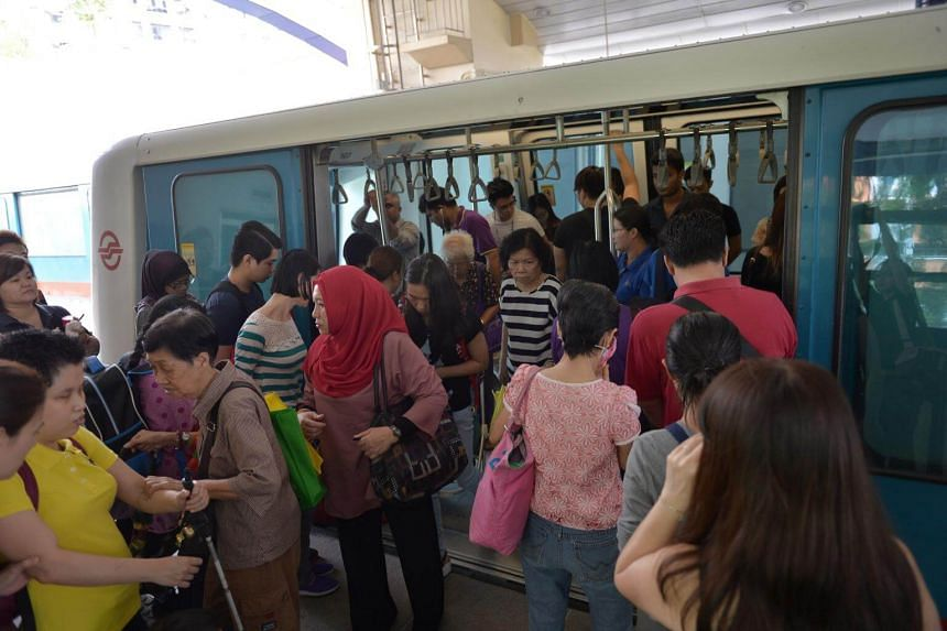 Commuters boarding an LRT train at Segar station after waiting for over 30mins on Sept 28, 2016.