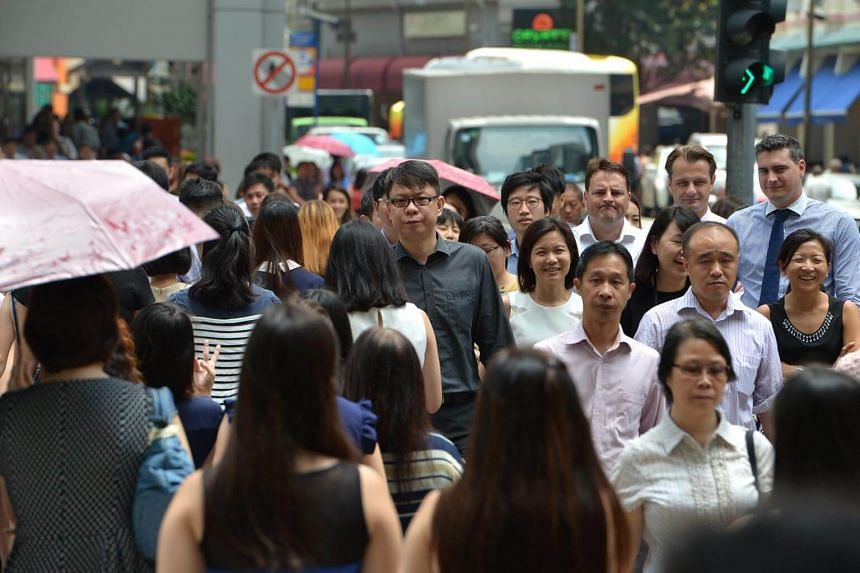 Office crowd in Central Business District (CBD). Most women in Singapore feel that they are not represented adequately in business leadership roles.