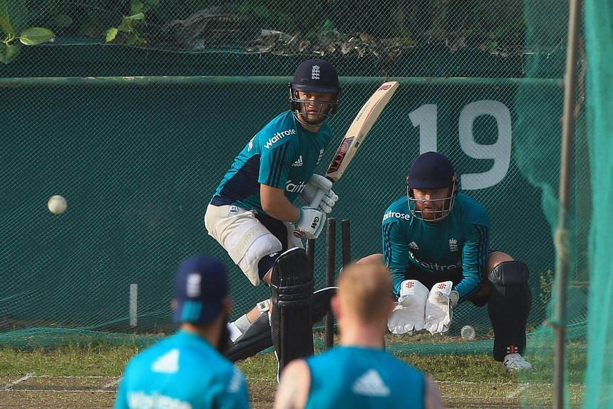 England cricket player Ben Duckett (centre) bats as he takes part in a practice session at the Sher-e-Bangla National Cricket Stadium in Dhaka, ahead of the first One Day International (ODI) match against Bangladesh on Oct 7, 2016.