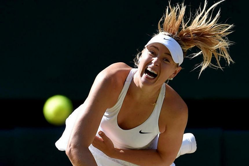 Maria Sharapova serves during her match against Serena Williams at the Wimbledon Tennis Championships in London, on July 9, 2015.