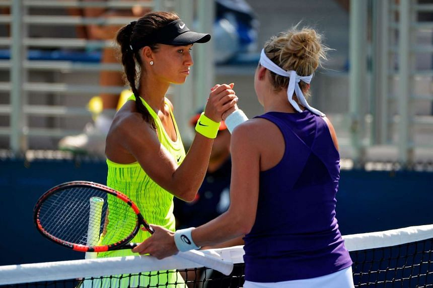 Vitalia Diatchenko of Russia shakes hands with Timea Bacsinszky of Switzerland after their first round Women's Singles match on Day Two of the 2016 US Open at the USTA Billie Jean King National Tennis Center on Aug 30, 2016.