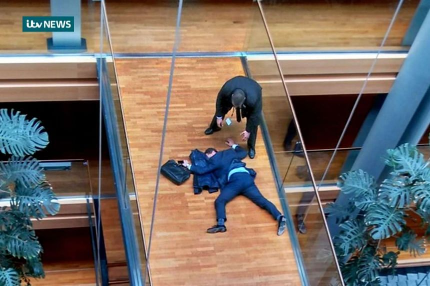 A handout picture shows MEP Steven Woolfe lying face-down on a walkway inside the European Parliament building in Strasbourg in eastern France.