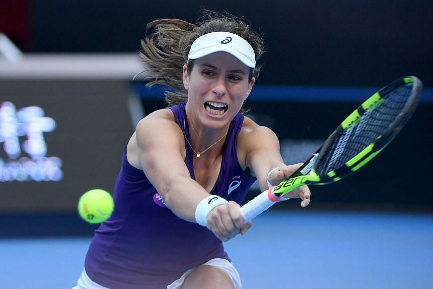 Johanna Konta of Britain hits a return against Madison Keys of the US during their women's singles semi-final match at the China Open tennis tournament in Beijing on Oct 8, 2016.