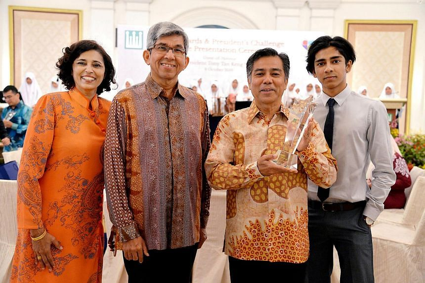 Mr Latiff Ibrahim (third from left) was honoured on Saturday (Oct 8) for his contributions to community work, at the annual Muis Awards ceremony.