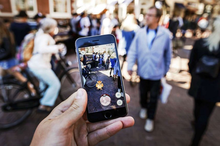 Gamers play the Pokemon Go app in the Netherlands on July 13, 2016.