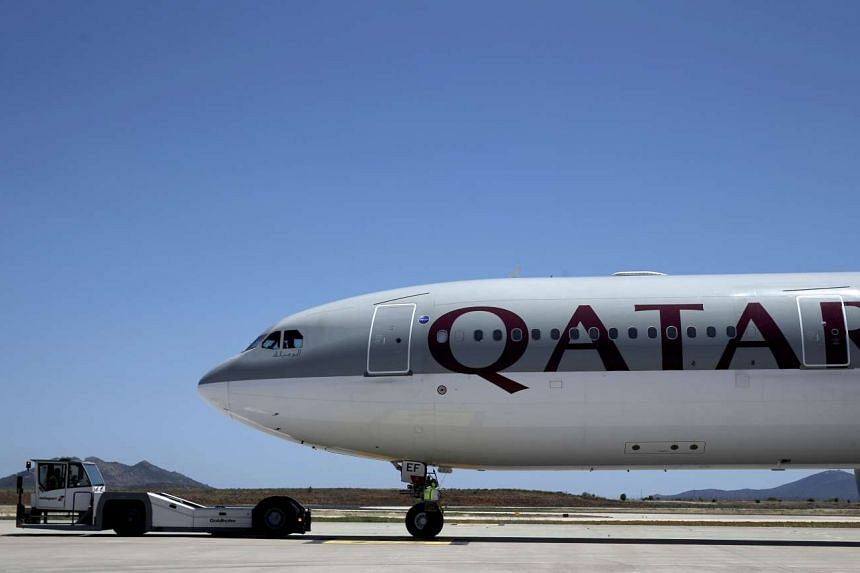 A Qatar Airways aircraft is seen at a runway in Athens, Greece, May 16, 2016.