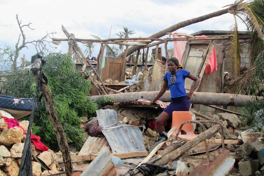 A woman looks on in the devasted town of Jeremie, west Haiti, following Hurricane Matthew in a handout photo.