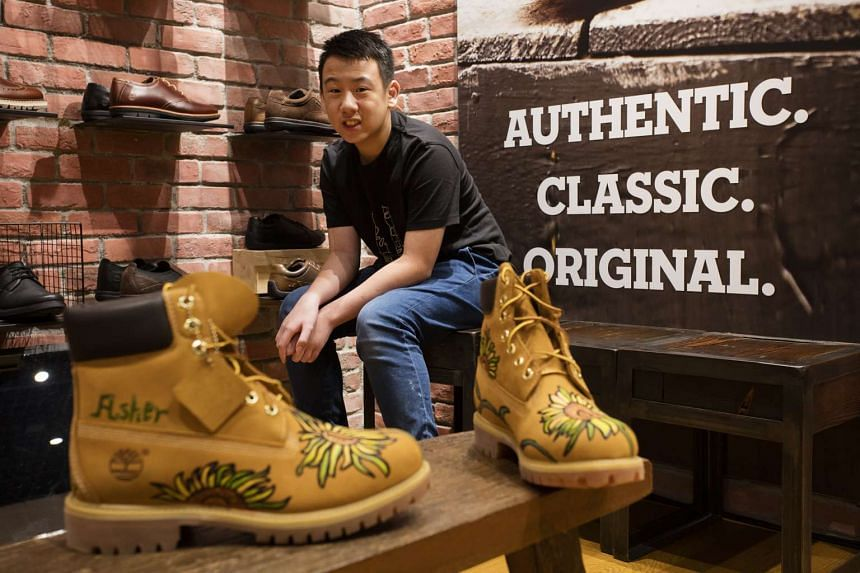 Pathlight School student Asher Ng, 13, and his specially designed pair of Timberland boots.