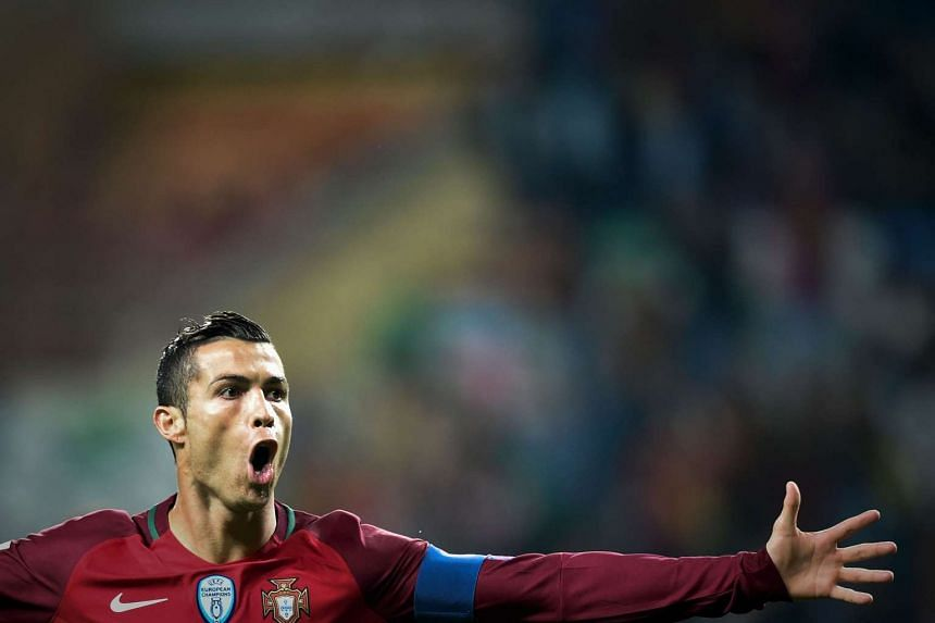Portugal's forward Cristiano Ronaldo celebrates after scoring a goal against Andorra.