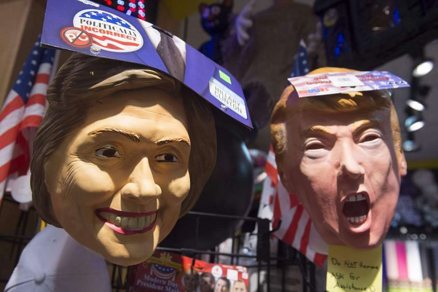 Halloween masks depicting Democratic Presidential candidate Hillary Clinton and Republican Presidential candidate Donald Trump are seen for sale at Total Party, a party store, in Arlington, Virginia.