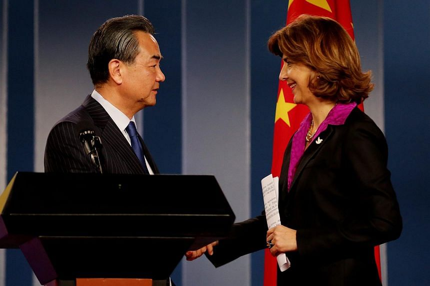 Chinese Foreign Relations Minister Wang Yi (left), shakes hands with Colombian Foreign relations Minister María Angela Holguin in Colombia on Oct 7, 2016.