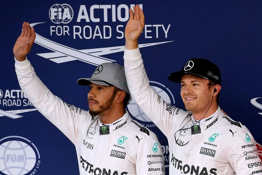 Mercedes's Nico Rosberg (right) takes pole position ahead of teammate Lewis Hamilton (left) during the qualifying session at the Formula One Japanese Grand Prix on Oct 8, 2016.