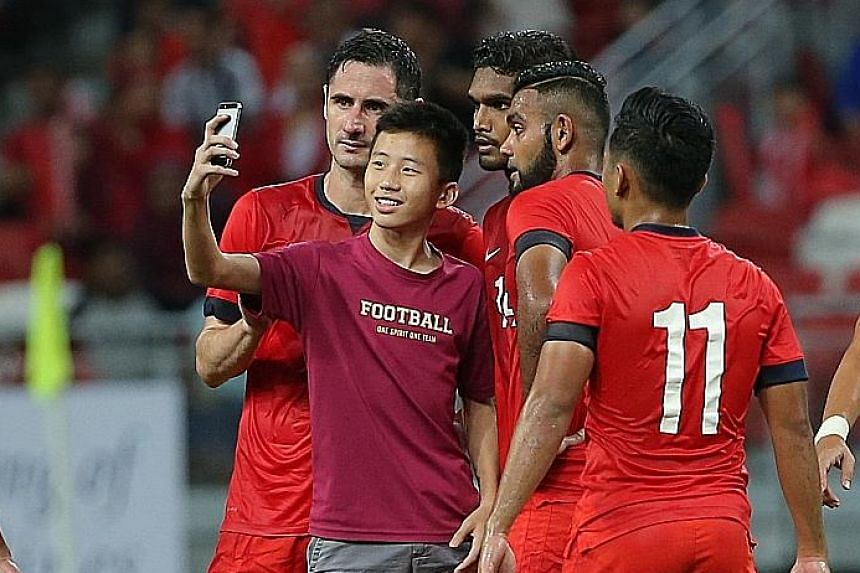 A young fan caused a minor stir when he walked up to the Singapore national team players to take a wefie after the whistle.