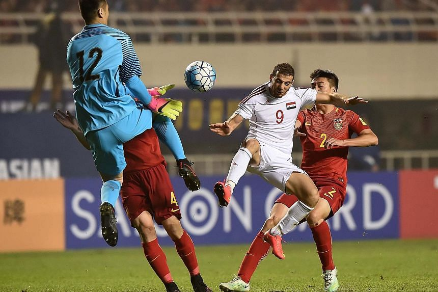 Mahmoud Al-Mawas of Syria latching on to a long pass to prod the ball past Chinese goalkeeper Gu Chao for the only goal of the World Cup qualifier in Xi'an. Fans took to social media to blast the underperformers.