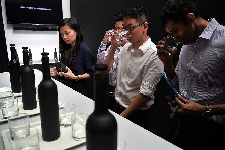 "Visitors sampling ""Asia's most expensive water"", priced at $1,260 a bottle, at a pop-up bar in Ocean Financial Centre. The campaign was launched by non-profit group Lien Aid yesterday to raise awareness that clean water is a luxury for many poor peop"